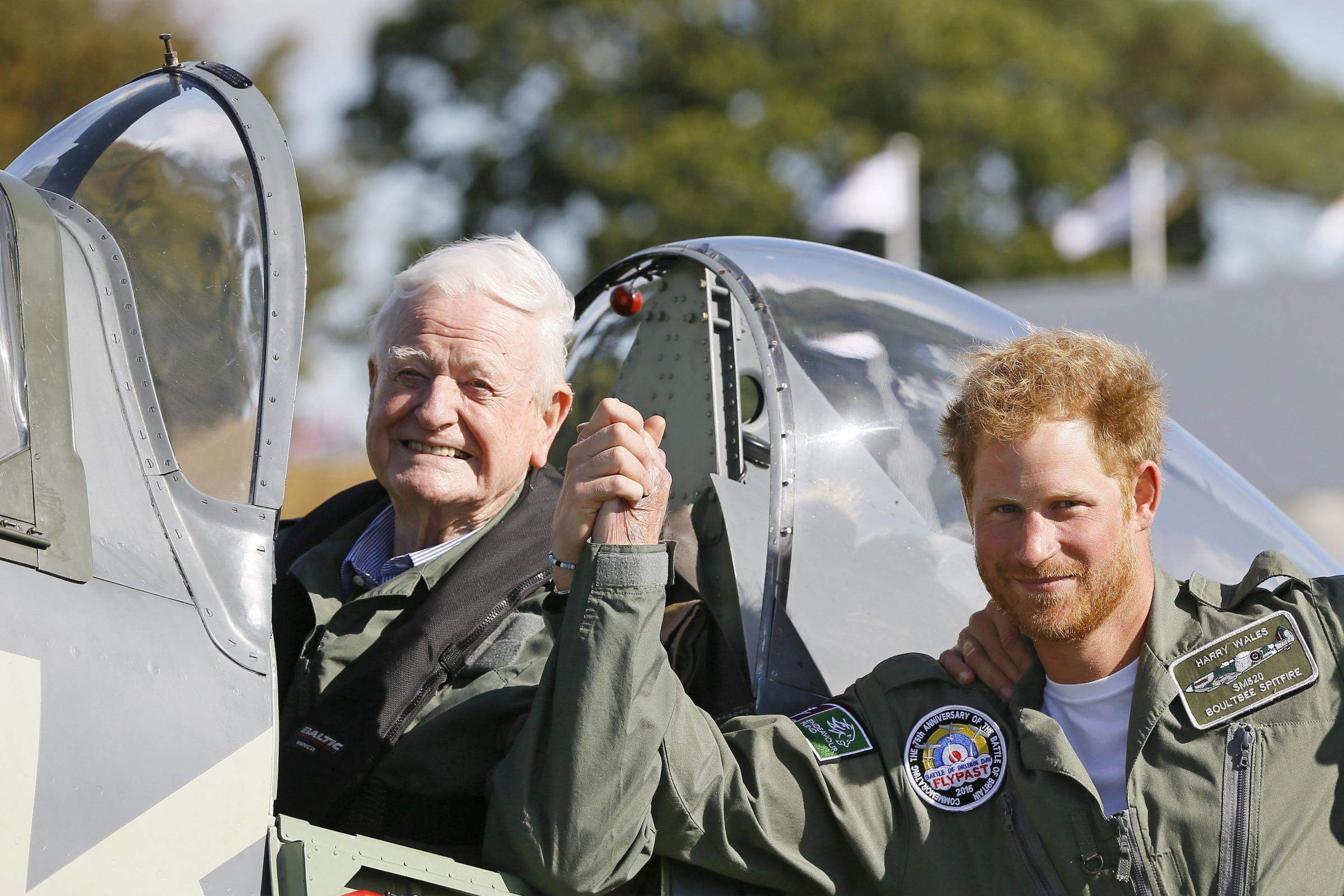 Wing Commander Tom Neil, who has died aged 97, meeting Prince Harry during Battle of Britain commemorations