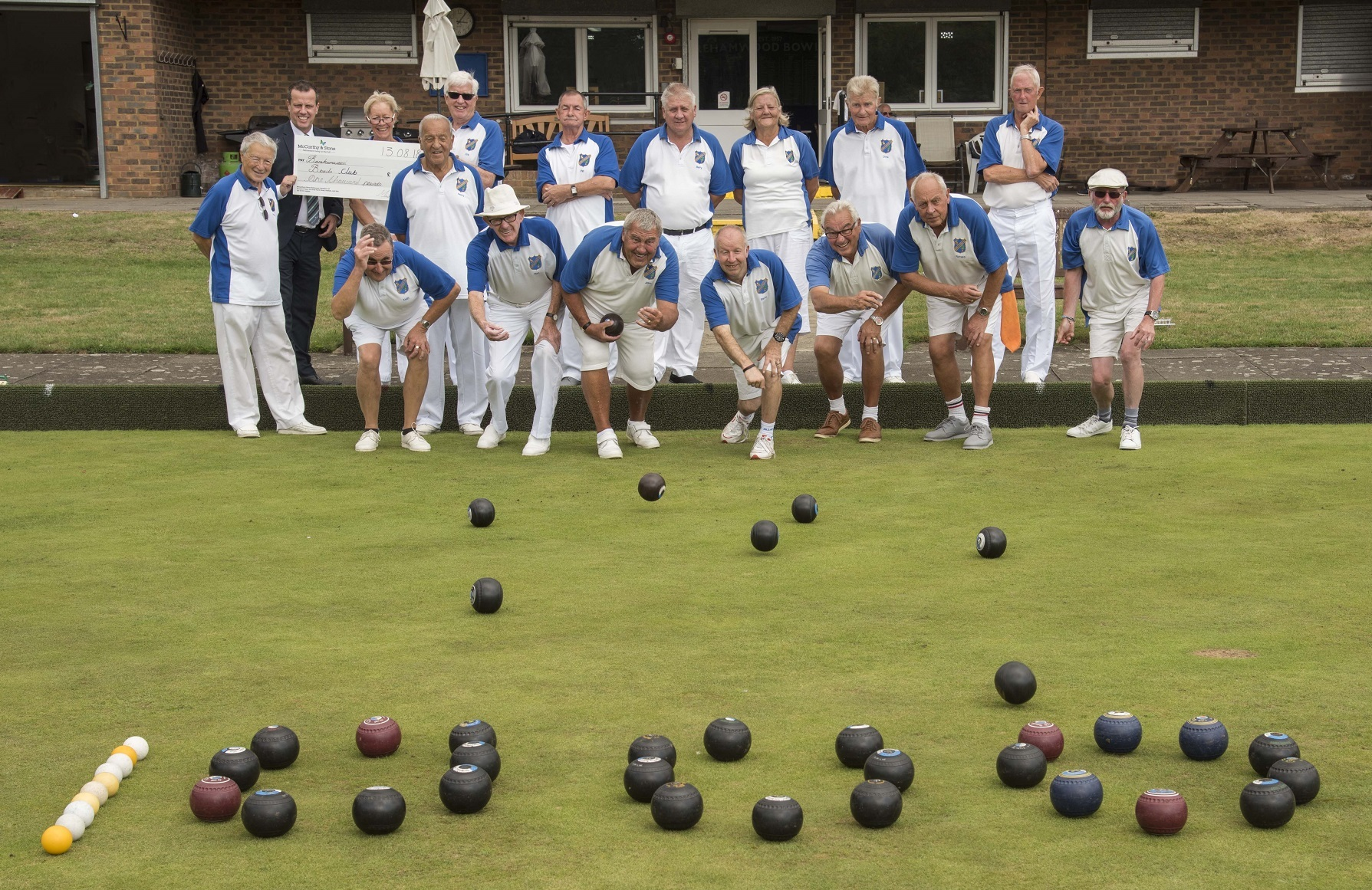 McCarthy and Stone's Stephen Key presents the cheque to a delighted Borehamwood Bowls Club