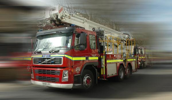Currently a fire engine is expected to reach a house fire within 10 minutes