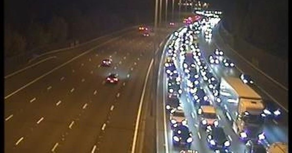 Yellow weather warning and two lanes closed on M25