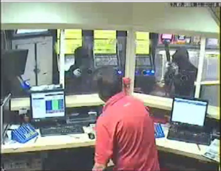 CCTV from one of the robberies at Ladbrokes. Picture: Met Police/Ladbrokes