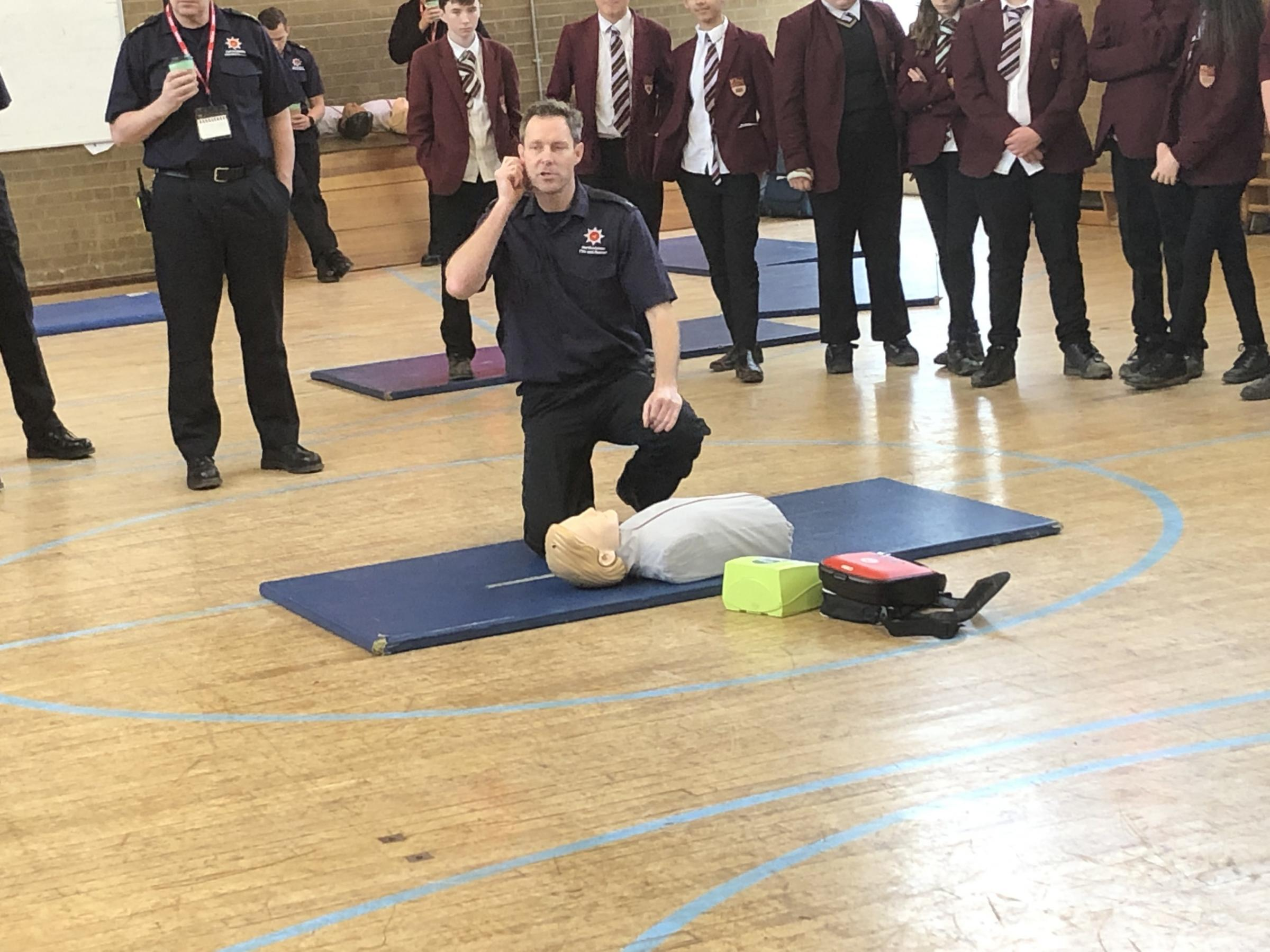 A fire officer gives first aid and CPR