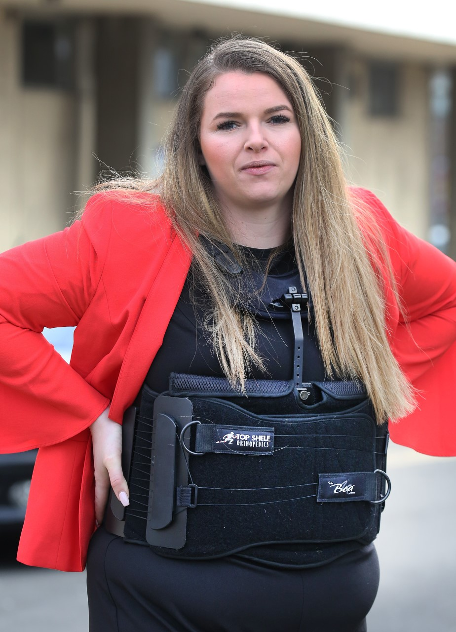 Danielle Wood outside St Albans Crown Court today wearing her support brace. Photo: SBNA