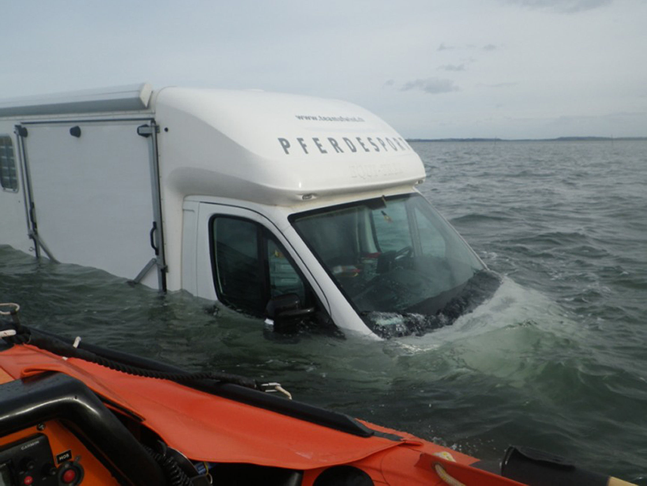 RNLI handout photo of horsebox type campervan partially submerged on Holy Island Causeway. Picture: PA/RNLIa